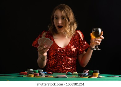 Portrait of a girl who plays poker in a night casino