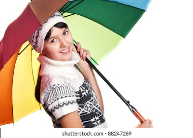 portrait of a girl in winter clothes with colored umbrella isolated on a white background