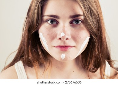 Portrait of girl woman with problem and clear skin creme, aging and youth concept with cream on face