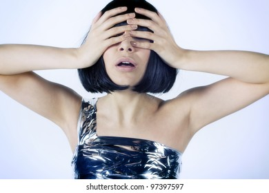Portrait of a girl's face was covered with her ??hands