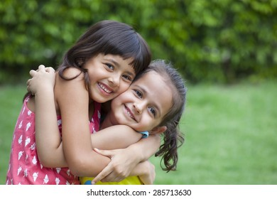 Portrait of girls hugging each other