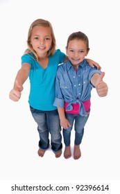 Portrait of girls with the thumbs up against a white background