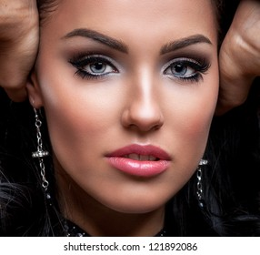 Portrait of a glamorous brunette girl with evening make up and long lashes