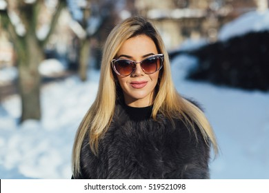 Portrait of a glamorous business woman in the winter street.