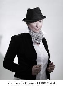 portrait of glamorous woman in a black hat