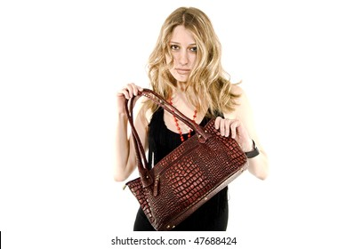 Portrait of a glamorous woman with  crocodile leather bag