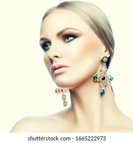 Portrait of glamour model woman, bright makeup, perfect skin, luxury jewelry earrings, blonde hair style, eye shadow makeup