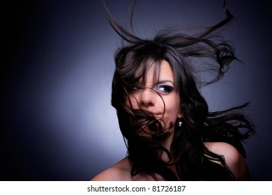 Portrait of glamour woman over dark gray background