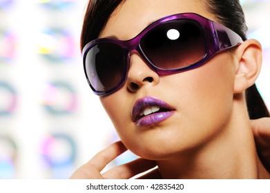 Portrait of glamour woman in purple fashion sunglasses
