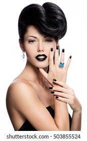 Portrait of glamour woman's nails , lips and eyes painted color black.  Girl with fashion  bright makeup.