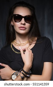 Portrait of glamourous young brunette posing in luxury jewelry