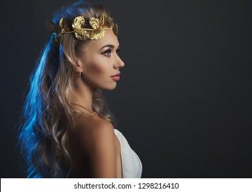 portrait goddess young woman on dark studio shot