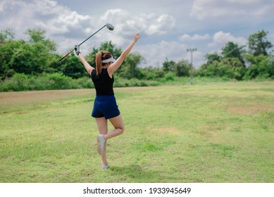Portrait of golfer asian woman holding golf wood at the country club,Happy woman concept