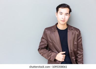 Portrait good looking man. Attractive handsome man look confident. Charming handsome young businessman get successful of his business. Cool guy wear leather jacket. He feel relaxed, happy. copy space