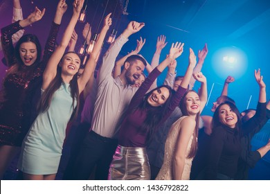 Portrait of good-looking formally dressed person millennial raise hand arms content rejoice close eyes enjoy holiday people enjoy fog smog free time dance floor dress suit trendy stylish  indoors