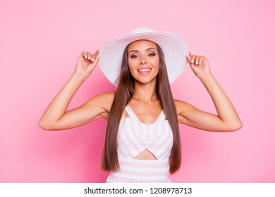 Portrait of good-looking good-wearing beautiful person with her long brunette hair she stands isolated on pastel vivid background look at camera hold panama two hands rest on vacation