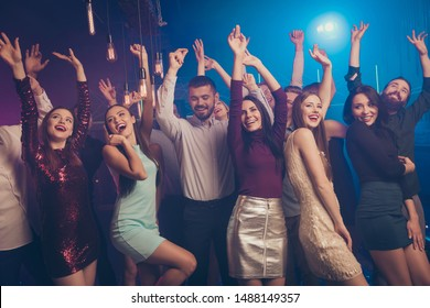 Portrait of good-looking nice pretty millennial raise hands laugh peopel anniversary move scream loud music formal wear suit dress skirt indoors amusement glow neon lights smoke