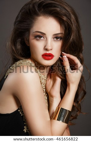 e3306c43b Portrait of gorgeous brunette woman with bright makeup and long dark hair.  Vogue style girl with red lips. Sensual young lady isolated on black  background