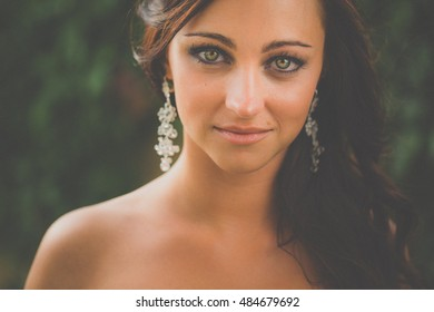 Portrait of a gorgeous brunette woman (color toned image; with some added grain and low contrast)