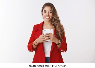 Portrait gorgeous confident stylish female wearing red jacket asking take picture holding smartphone smiling broadly like taking selfie mirror looking good outfit, posting images online