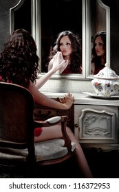 Portrait of gorgeous girl looking in mirror