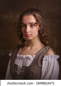 Portrait of a gorgeous girl in medieval time dress