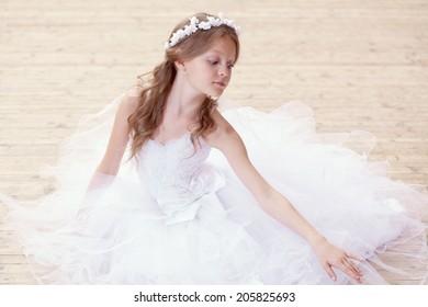 Portrait of gorgeous little ballerina dancing