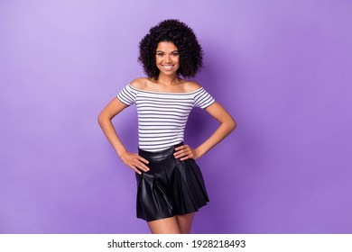 Portrait of gorgeous positive dark skin lady put hands on waist toothy smile isolated on purple color background