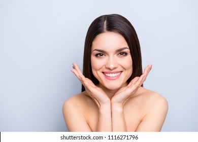 Portrait of gorgeous toothy woman presenting perfect smooth soft idyllic face skin isolated on grey background. Detox botox collagen vitamins minerals wellness wellbeing enhancement concept