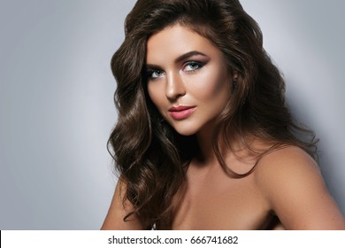 Portrait of gorgeous woman with a beautiful make-up and hairstyle