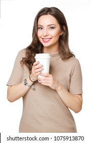 Portrait of a gorgeous young brunette woman having coffee.