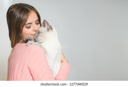 Portrait of a gorgeous young brunette woman  with her cat.