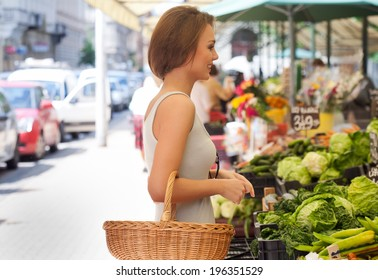 Portrait of a gorgeous young brunette woman shopping for groceries.