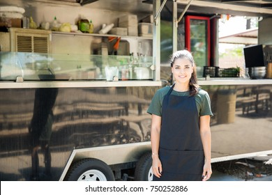 Portrait of a gorgeous young Hispanic food truck owner ready to cook