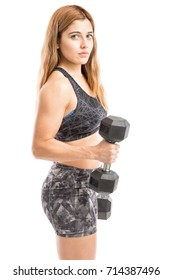 Portrait of a gorgeous young strong woman lifting some weights and working on her biceps
