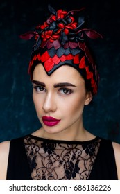 Portrait of gorgeous young woman with beautiful make-up wearing elegant headdress, floral wreath