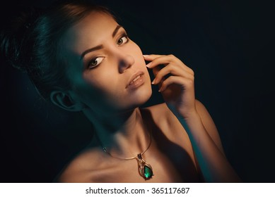Portrait of gorgeous young woman with necklace