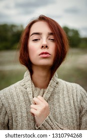 portrait of gorgeous young woman in sweater