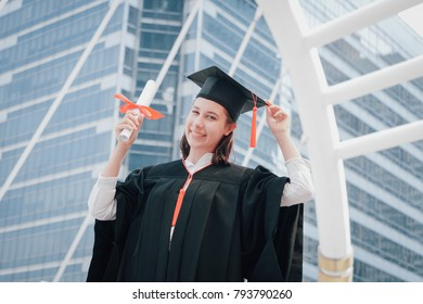 portrait of Graduate woman students wearing graduation hat and gown