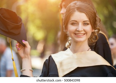 Portrait of graduated student on university campus