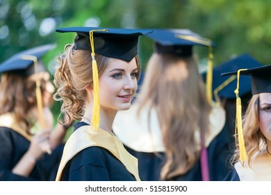 Portrait of graduated student on university campus