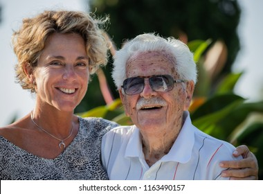portrait of a grandfather over 100 years old and his granddaughter over 45 years old
