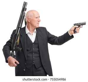 Portrait of grandfather in a suit holds a shotgun on his shoulder, in the other hand gun, isolated on a white background