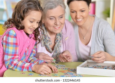 Portrait of grandmother with daughter and little granddaughter