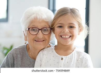 Portrait of grandmother with granddaughter