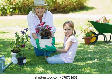 Portrait of a grandmother and granddaughter engaged in gardening