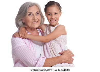 Portrait of grandmother hugging with her cute granddaughter