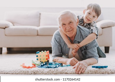 Portrait Grandpa and Grandson Playing with Toys. Family Relationship Between Grandfather and Grandson. Grandpa Teaching, Male Grandchild, Learning Concept. Relations and People Concept.