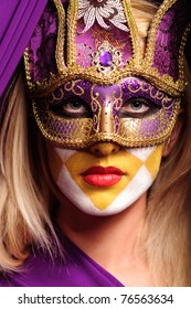 Portrait of grave woman in carnival violet mask