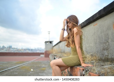 portrait with green dress on the terrace